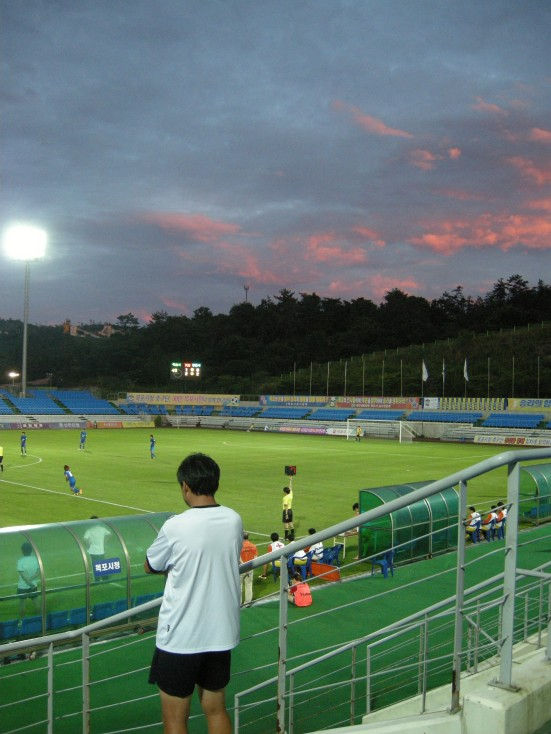 Mokpo coach Kim watches from the stands