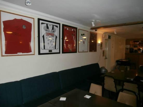 Some of the club bar's football shirt memorabilia.