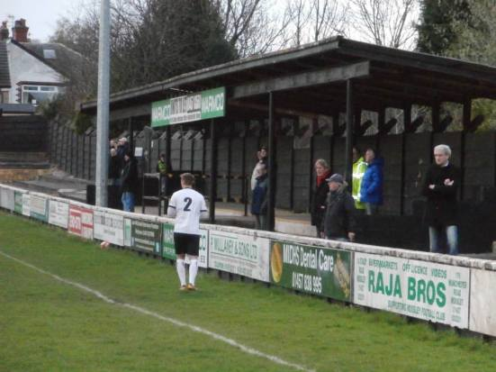 The small sheltered standing terrace opposite the main stand.