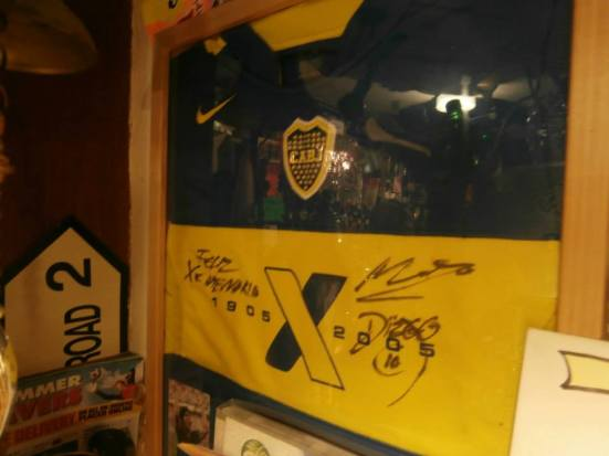 The signed Maradona shirt in the Globe (I actually owned a replica of that Boca shirt too).