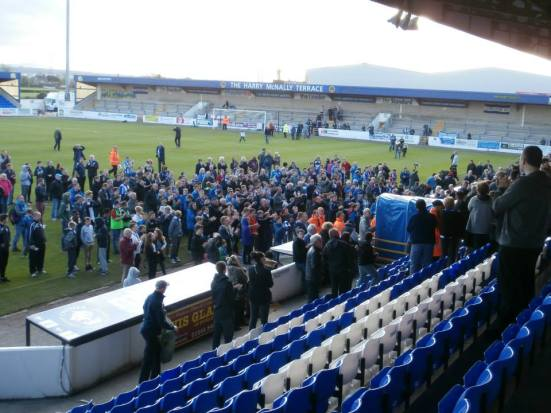 The fans wait for the players and manager to re-emrge from the Exacta Stand.