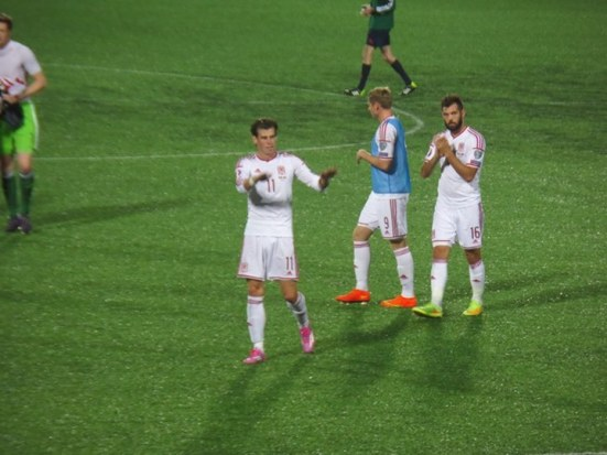 Bale calms down the pitch invaders.