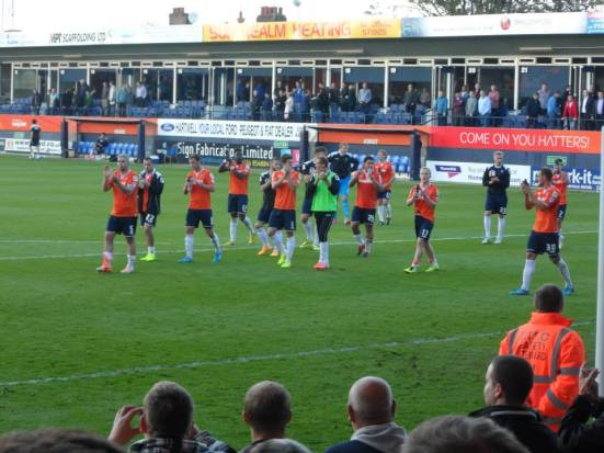 Luton Town get their applause from the home fans. Well-earned.