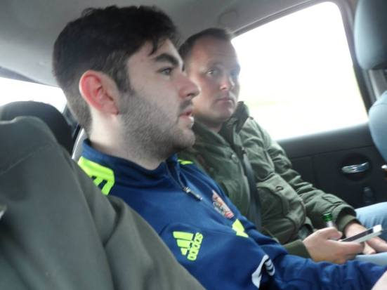 Lee and Gibbo squashed in with me in the back of Frank's car.