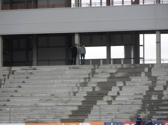 Two spectators try out the new stand by themselves.