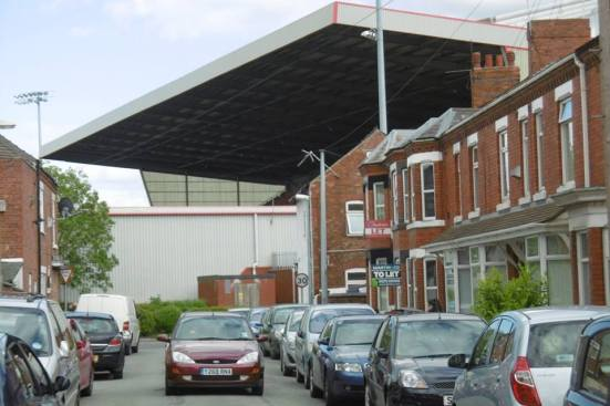 Gresty Road's Main Stand towering over the streets around it.