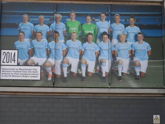 Image of the City Ladies team on the time line going around the outside of the Etihad Stadium.