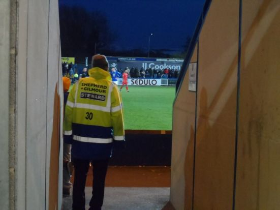 A steward watches on.